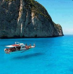 Zakinthos , Greece.  Water so clear looks like boat is in the air!