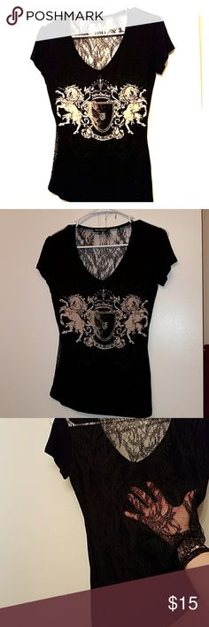 Black shirt with lace on back Sexy black Royal underground T-shirt with lace all on the back size small will look great with a pair of jeans especially Miss Me jeans with the bling Royal Underground Tops