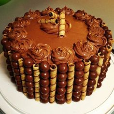 5 Layer Chocolate Cake with Milk Chocolate Icing Surrounded by Whoppers and Pirouette Cookies