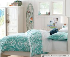 Lovely bedding, and surfboard.