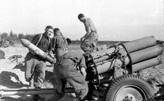 "German artillerymen charged ""Nebelwerfer 41"" MLRs"