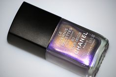 ... an iridescent combination of lavender and old gold tones, it can flash bronzey-taupe one minute, then immediately turn into a dusky purple.