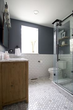 Starting a bathroom or kitchen renovation? Here are 5 things to know going into your first big home improvement project. Plus, a gorgeous before and after of this master bathroom complete with marble floor tile, subway tile, and a large wood vanity. #bathroom #bathroomdesign #homeimprovement #homerenovation Eclectic Bathroom, Modern Bathroom, Master Bathroom, Vanity Bathroom, Diy Playbook, Wood Vanity, Beautiful Interiors, Home Improvement Projects, Home Renovation
