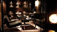 FAbulous use of lighting in the alcoves. The leather and steel and wood make this a masculine yet warm and inviting study lounge