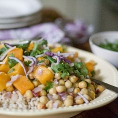 Roasted butternut squash over farro and chickpeas with a spicy yogurt dressing.
