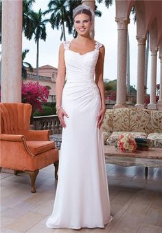 Asymmetrical ruched fit and flare Jersey gown with embroidered lace Queen Anne neckline and an illusion plunging back with scattered embroidered lace. The gown is finished with a side zipper and a sweep length train.