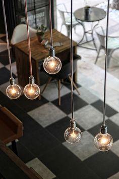 Asymmetrically hung pendant bulbs