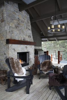 Rustic- Living rooms open floor plan with kitchen. Stone fireplace, and simple furniture with animal print. Also, large windows for natural light. Adorondack Chairs, Outdoor Rooms, Outdoor Living, Rustic Outdoor, Log Homes, Living Spaces, Living Rooms, Sweet Home, House Design
