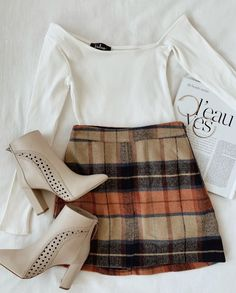 Plaid Beige Plaid Mini Skirt A plaid skirt outfit is an essential look for fall fashion. The colors of autumn come together in a checker pattern throughout the mini skirt. Style with a simple. Cute Fall Outfits, Fall Winter Outfits, Autumn Winter Fashion, Casual Outfits, Fall Skirt Outfits, Fall Fashion Skirts, Plaid Outfits, Winter Clothes, Beige Skirt Outfit