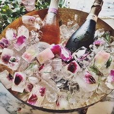Petal ice cubes in champagne bucket
