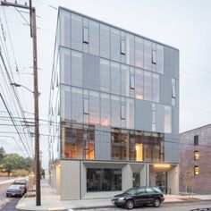 Glass facade reveals timber structure of Frame Work building in Portland
