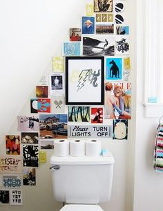 love the idea of covering a bathroom wall with postcards and prints of favorite artwork