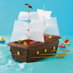 """Piratenschiff-Torte The perfect cake for adventurous kids. """"Pirates of the Caribbean"""" fans set the ship in a wild sea of crinkled, blue tissue paper. Cake Recipes With Pictures, Food Pictures, Pirate Birthday, Pirate Party, 20 Birthday, Birthday Ideas, Pirate Ship Cakes, Pirate Boat Cake, Food Humor"""