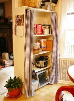 This is exactly what I did in my kitchen, getting the idea from Dina Z. because she took out all her cabinets and had everything exposed - love it! Repurpose a bookshelf for a pantry in the kitchen.  Make curtain panels with pinch clips to slide on wooden curtain rod.