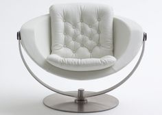 Alfa Lux from the Danish company Nielaus Furniture is a one of a kind masterpiece loung chair with a phenomenal design, which brings reminiscent of the 60s organic and round shapes. The exclusive design is achieved through a beautiful combination of a molded hard shell, comfy seat and backrest cushions in a variety of high quality fabrics or leather, and the base and suspended hanger in laser cut polished stainless steel.