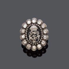 DIAMANT-RING, Österreich, um 1916. Silber und Gelbgold. Dekorativer Ring, die Schauseite besetzt mi