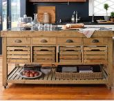 Rustic kitchen island by Williams-Sonoma with root vegetable storage