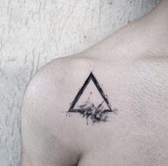 Triangle tattoo by Cansu Olga