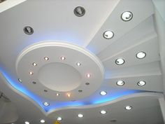 white round ceiling from plastic board with small round lights