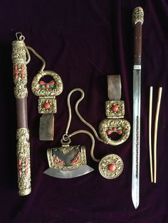 A set of belt ornament with knife, chopsticks, tinder pouch, toggle and pendant for Mongolian men, decorated with fine gilt silver filigree work, inlaid coral and turquoise. 19th c, Mongolia