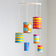 Tin-Can Wind Chime ... Oh, I could SO SEE THESE DONE UP IN HALLOWEEN colors and decor.