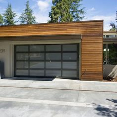 Depending on the design of your home, your garage door (or doors) can take up a lot of real estate on the front of your house. Replacing your garage door, especially if it's a standard builder-grade sectional door, with something… Continue Reading → Glass Garage Door, House Exterior, Modern Garage Doors, Exterior Design, Garage Roof, Modern Garage, Detached Garage Designs, Garage Door Design, Flat Roof Design