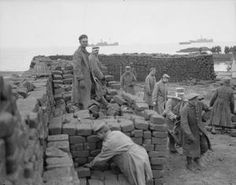 WWI, Feb 1917, Salonika: German POWs carrying and stacking bricks. ©IWM (Q 32760)