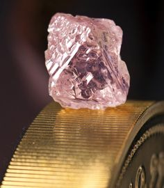 This photo, released by mining giant Rio Tinto on February 22, shows a 12.76 carat pink diamond -- the largest of the rare and precious stones ever found in Australia. Named the Argyle Pink Jubilee, the rough stone was found at Rio's pink diamond operations in the Kimberley region of western Australia and would take 10 days to cut and polish in Perth. (AFP Photo/)