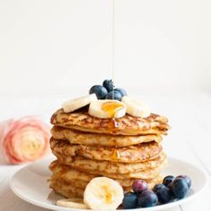 These thick and fluffy vegan pancakes are made with only 4 ingredients! Get the easy fail-proof recipe and tips on how to use different types of flour.
