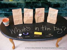 "What's in the Bag? - children have to guess, based on lifting (is it heavy or light?), shaking (is it loud or quiet?) squishing (Is it soft or hard/big or small?) ("",)"