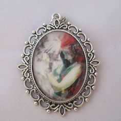 This stunning necklace features two lovers in an embrace.  #hummingbirdmges #htlmp #britcraft #hmuk #craftbuzz #gotshop #gotshophr #readytoship #handmade #jewellery #necklace #cameo #lovers #embrace