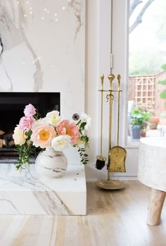 Make every season a little brighter by filling your home with creative flower arrangements. Try using a mortar and pestle set as a vase? The greens and pastel hues of the flowers play beautifully next to the rugged texture of the container. Farmhouse Fireplace, Faux Fireplace, Marble Fireplaces, Modern Fireplace, Fireplace Drawing, Fireplace Bookshelves, Victorian Fireplace, Concrete Fireplace, Bedroom Fireplace