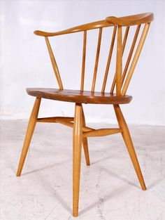 Hey, good lookin'! We're loving this vintage Ercol elm and beech cow horn carver chair.