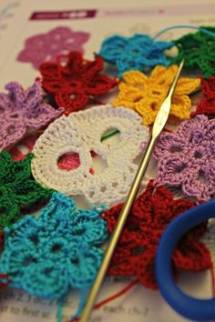 Cool crochet skull with flowers by Heather C. on Hookey :D Love these projects!.