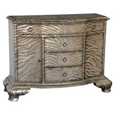 Add a pop of pattern to your entryway or living room with this eye-catching chest, showcasing a zebra-print front and 4 drawers for ample storage.