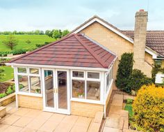 This bespoke white uPVC conservatory was finished with a sleek brown tiled roof for a streamlined and truly beautiful design. Tiled Conservatory Roof, Conservatory Ideas, Roof Extension, Extension Ideas, Roofing Systems, Double Glazed Window, Roof Design, Gazebo, Outdoor Structures