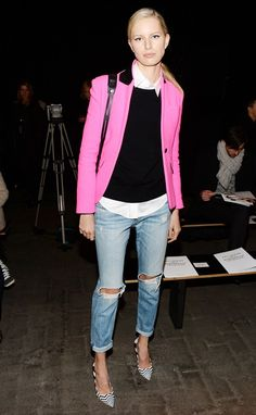 Copy Karolina Kurkova's pairing of a structured jacket with a lightweight sweater to make your jeans office-appropriate