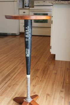 old baseball bats converted into table legs... cute in a boys bedroom for bed frame, or table legs, or bookcase supports..... cute