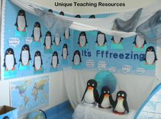 "This is a penguin and winter bulletin board display titled ""It's Fffreezing!""  Students wrote stories inside the penguin projects that they designed.  From:  Unique Teaching Resources"