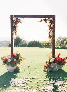 Fall floral-adorned wedding arbor / http://www.himisspuff.com/fall-wedding-arch-and-altar-ideas/2/