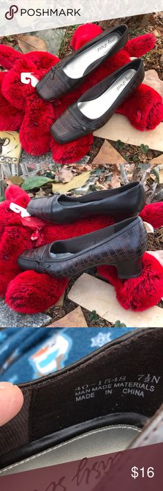 "Easy Street Faux Croc Alligator Pumps Shoes 7.5N Easy Street Faux Alligator Croc Slip On Pumps Shoes are size 7.5 Narrow. Shoes have indents in right shoe right side of heel and minor scuffs on inner side of shoes. They look to be brand new but I don't know the history of the shoes. Most of shoes are the faux gator design while the rest is solid brown. Toes have a ""tied ribbon"" in a knot. Made in China of all man made materials. Easy Street Shoes Heels"