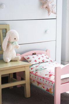sweet little doll bed and quilt on nanacompany. The chenille bunny is thinking about hopping in for a snuggle.