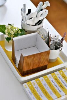 A simple tray with a beutiful paper and you can corall bits and pieces and make it less cluttered