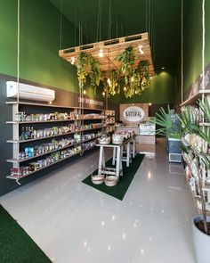 This Natural Foods store has sectioned off areas of tile and fake grass, the whole space promoting a natural feel to match their merchandise. Supermarket Design, Retail Store Design, Store Plan, Eco Store, Pharmacy Design, Boutique Decor, Cosmetic Shop, Retail Interior, Shop Interiors