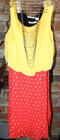 Polka dots, pleats, and bright yellow.  #CrushingthisSpring