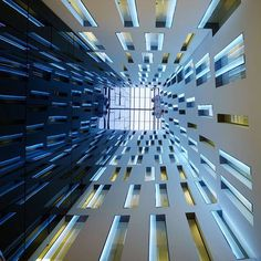 Wortmann Architects, Guillermo Bañares Arquitectos, and Carlos Narváez joined forces to design Spain's magnificent Gaudí-inspired Hotel Ayre. By installing LED strips on window panes—controlled by computerized coordination—the architects created a dynamic sound and light sculpture in the hotel's atrium. Always remember to look up! : Stefan Müller. #architecture #interior #design #interiordesign #hotel #spain
