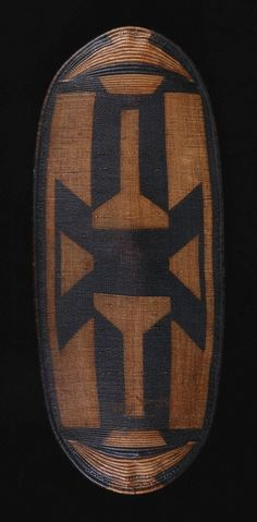 Zande or a closely related group Place made: Democratic Republic of the Congo Shield, 20th century Wood and woven vegetable fiber h. 134.0 cm., w. 56.0 cm., d. 11.0 cm | Princeton University Art Museum