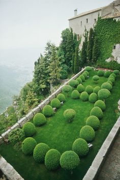 In Provence, France, topicary spheres punctuate a sloping, hillside garden.