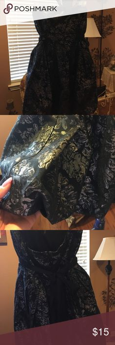 Blk n Silver party Dress sz L Size Large strapless, shiny blk n Silver party dress that is gathered at the bottom with blk tie in the back for bow. Extent condition! Kept in plastic! XXI Dresses Strapless