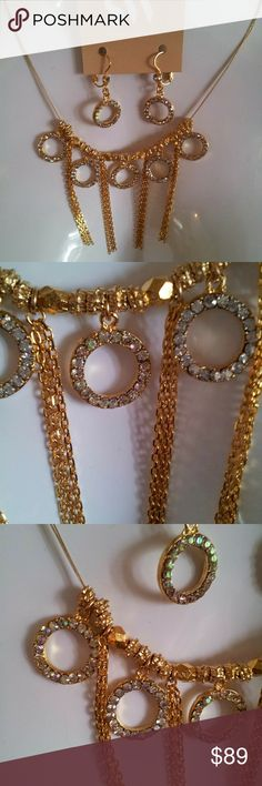 "AUTHENTIC Seasonal Whispers Necklace set. Beautiful Swavrosky crystals circle necklace set.  Super cute shiny Crystals.   Includes Necklace and earrings  Necklace 15"" long with a 2"" extender. Earrings measures APPROX 1"" Circles on the necklace APPROX 3/4"" Chains on the necklace APPROX 2"" long  In you need to see measurements pictures please feel free to ask. SEASONAL WHISPERS Jewelry Necklaces"
